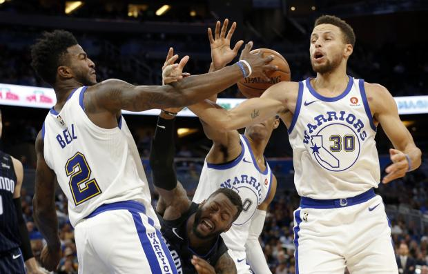Golden State Warriors forward Jordan Bell (2), guard Stephen Curry (30), guard Patrick McCaw (0) and Orlando Magic forward Jonathon Simmons (17) go after the rebound during the second half at Amway Center. Photo: Kim Klement-USA TODAY Sports