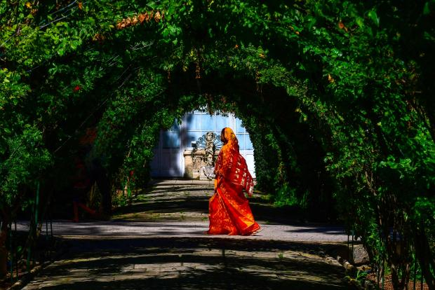 A woman profiting from the fine weather takes a stroll through the picturesque San Anton Garden on March 13. Photo: Jonathan Borg