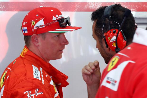Kimi Raikkonen (left) talk with his mechanic after the opening session of the Belgian GP.