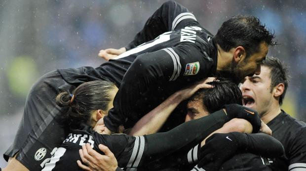 Juventus's Andrea Pirlo (bottom 2nd R) celebrates with his teammates after scoring against Parma