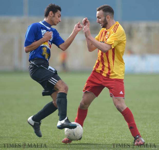 Fist fight... Tarxien's Luke Zahra (left) in a tussle for the ball with Birirkara's Ryan Scicluna at the Hamrun Stadium on January 10. Birkirkara won 2-1. Photo: Matthew Mirabelli