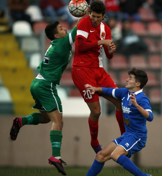 Valletta's Federico Falcone (centre) beats Tarxien Rainbow's goalkeeper Andrea Cassar and Timothy Tabone Desira to score his side's equaliser during their Premier League football match at the Tedesco Stadium in Hamrun on January 16. Photo: Darrin Zammit Lupi