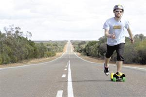 British skateboarder David Cornthwaite rides his skateboard in outback Western Australia. Mr Cornthwaite completed a 5,820 kilometre skateboard trip from Perth to Brisbane yesterday.