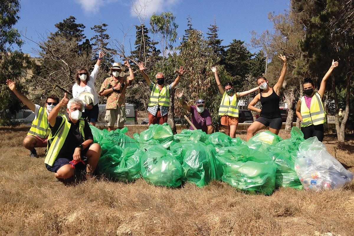 A group of volunteers after a litter-picking event at Ulysses Grove, Xewkija.