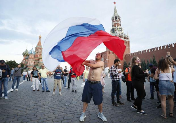 A Russia fan celebrates their shock victory over Spain. Photo: Reuters