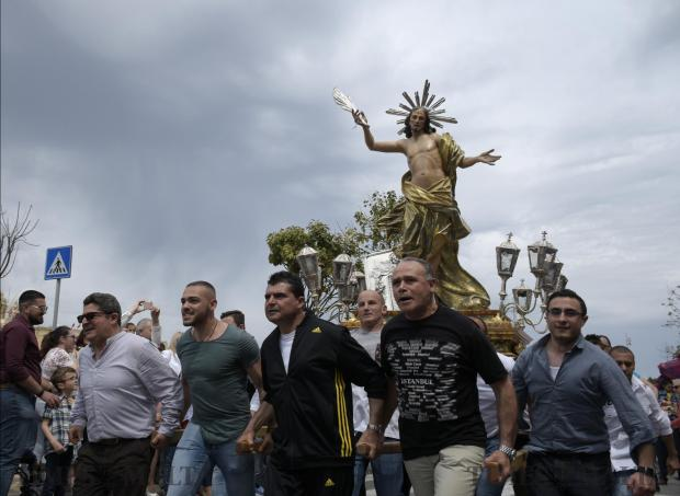 Procession goers run with the statue of the risen Christ during a procession in Cospicua on April 16. Photo: Mark Zammit Cordina