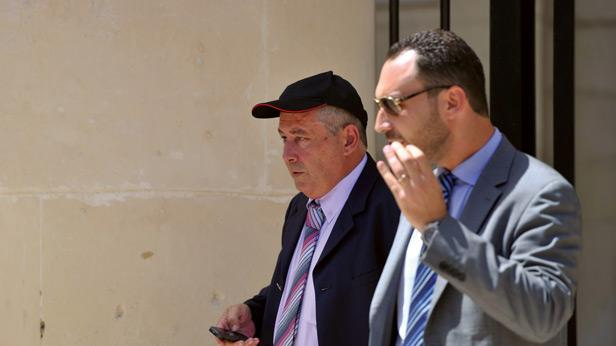 Shooting victim Vince Muscat, also known as Il-Koħħu (left), leaving the law courts in 2014.