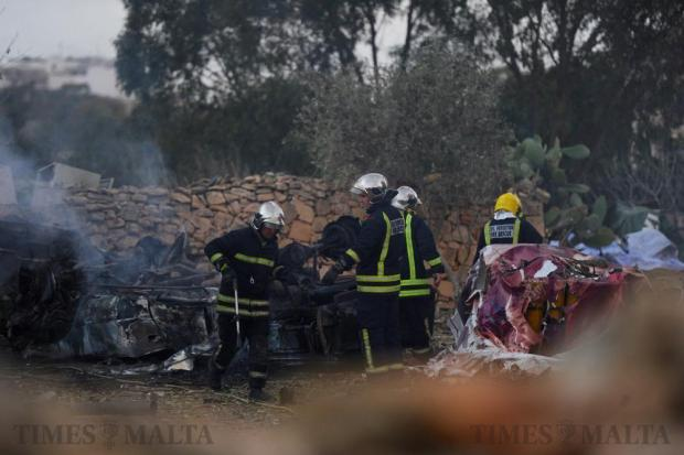 Firefighters battle the last flames after a fireworks explosion in Gudja on October 30. Photo: Steve Zammit Lupi