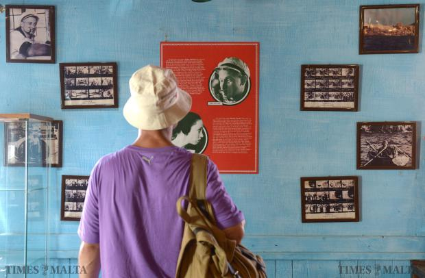 A tourist pauses in front of a wall covered with photos of Robin Williams in character as the one-eyed sailor in Popeye Village in Mellieha. on August 12.The actor was found dead at his California home on Monday following a long period of depression. Photo: Matthew Mirabelli