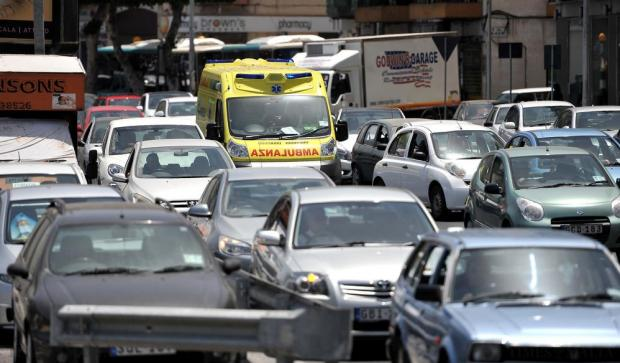 An ambulance tries to get through a traffic jam at Msida on June 15. Photo: Chris Sant Fournier