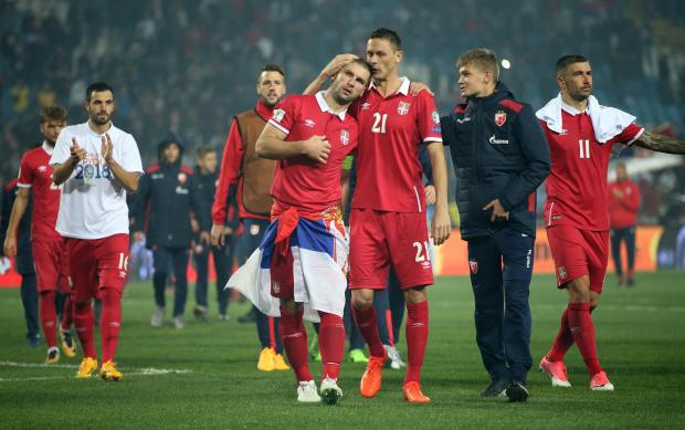 Serbia's Branislav Ivanovic and Nemanja Matic celebrate World Cup qualification after the match.