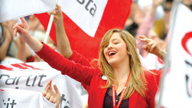 A Labour supporter cheers while sitting on her friend's shoulders during the party's first mass meeting in Gozo yesterday. Photo: Chris Sant Fournier