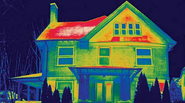 Heat loss (shown in red) from a roof which is not well insulated in a northern climate at night can be seen in this thermogram.