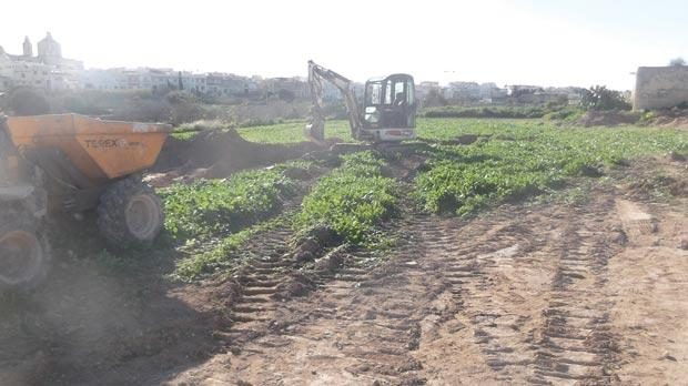 Election time does not hinder Mepa enforcement from doing its work. It recently ordered a mechanical shovel (above) to be removed from fields at Għaxaq and topsoil to be reinstated.
