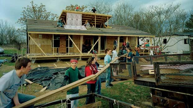 American architecture students collaborating on a Rural Studio project, known as Rosa Lee's House, for disadvantaged people and their families in the US.