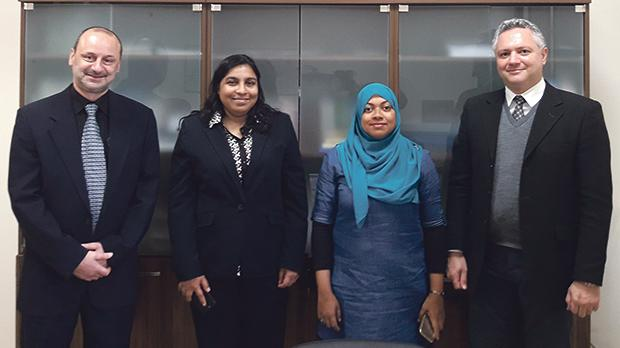 University of Malta pro rector Prof. Godfrey Baldacchino (left) and Dr Ruben Paul Borg flanking Aishath Shaheen (second from left) and Fathimath Shadiya.