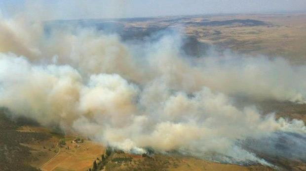 Plumes of smoke rise from a fire near Cooma, Australia. Photo: PA/New South Wales Rural Fire Service