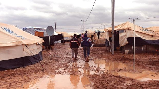 Hundreds of tents at a Syrian refugee camp were destroyed by heavy rain, causing a stampede in which aid workers were killed. Photo: PA