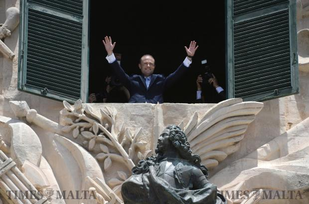 Joseph Muscat, waves to the crowds gathered outside the Auberge de Castille after being sworn in as Prime Minister of on June 05. Photo: Matthew Mirabelli