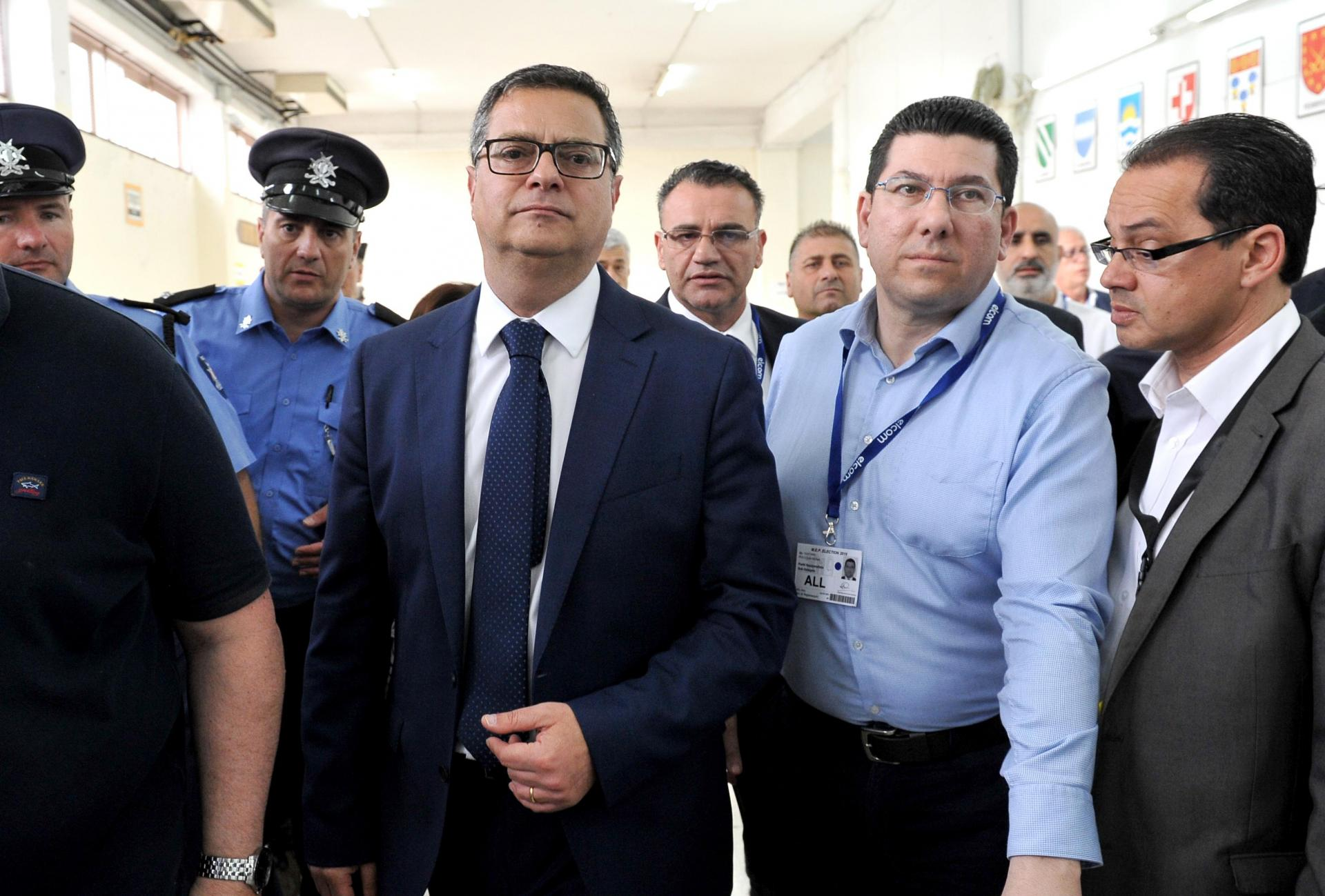Clyde Puli (second from right) leads party leader Adrian Delia through the Naxxar counting hall during the 2019 MEP and local council elections.