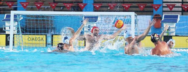 Paul Fava (no.11) scores for San Ġiljan against Sliema on Tuesday. Photo: Wally Galea