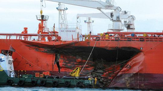 A 10-metre gash on the port side of a Malaysian-registered tanker Bunga Kelana after the collision. Photo/Aziz Hussin/Straits Times/AFP