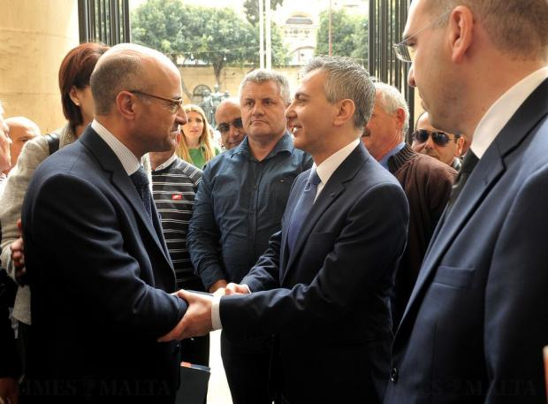 Opposition leader Simon Busuttil and Shadow Justice Minister Jason Azzopardi greet each other at the courts in Valletta on April 6. Photo: Chris Sant Fournier