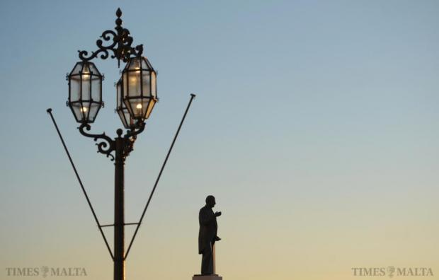 The sun sets behind the George Borg Olivier monument in Valletta on November 10. Photo: Matthew Mirabelli