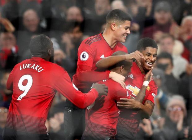 Manchester United's Marcus Rashford celebrates scoring their fourth goal with team mates