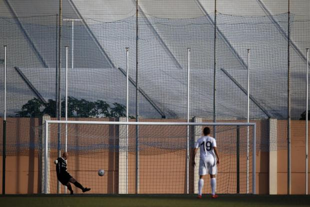 Msida St Joseph's reserve goalkeeper Matthew Camilleri gives a goal kick during their Division One football match against Gudja United at the Centenary Stadium in Ta' Qali on December 20. Photo: Darrin Zammit Lupi