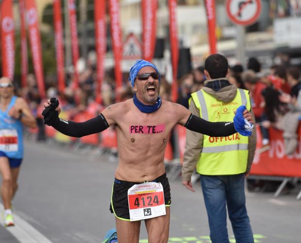 A Runner has tape stuck to his chest with the Italian words 'Per Te' (for you) at the finish line of the Malta Half Marathon in Sliema on February 25. PHOTO: MARK ZAMMIT CORDINA.