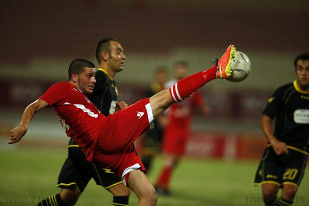 Balzan's Justin Grioli clears the ball away from Qormi's Joseph Chetcuti during their Premier League match at the National Stadium in Ta' Qali on August 27. Photo: Darrin Zammit Lupi