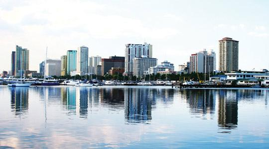 The skyline of Manila Bay. Four licences to build Entertainment City on reclaimed land along the bay were awarded in 2008.