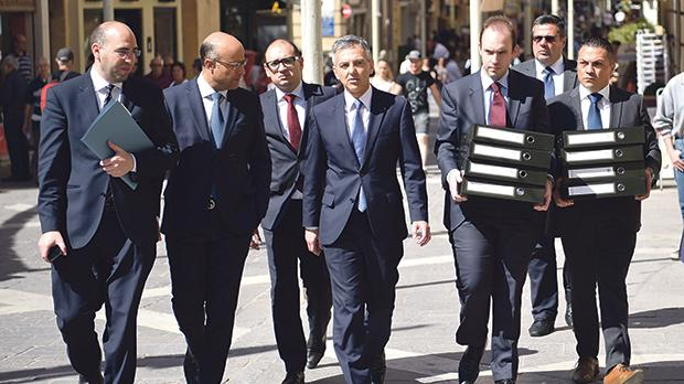 Simon Busuttil and his team on the way to court. Photo: Mark Zammit Cordina