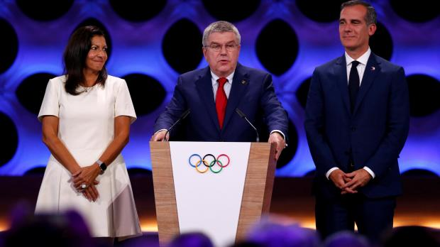 International Olympic Committee (IOC) President Thomas Bach next to Mayor of Paris Anne Hidalgo and Mayor of Los Angeles Eric Garcetti.