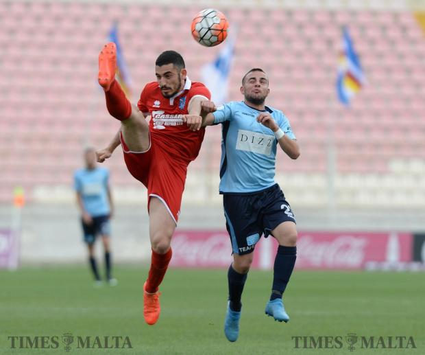 Tarxien Rainbow's Sacha Borg (left), beats Sliema's Ryan Spiteri to the ball during their FA trophy match at the National Stadium in Ta'Qali on May 13. Photo: Matthew Mirabelli