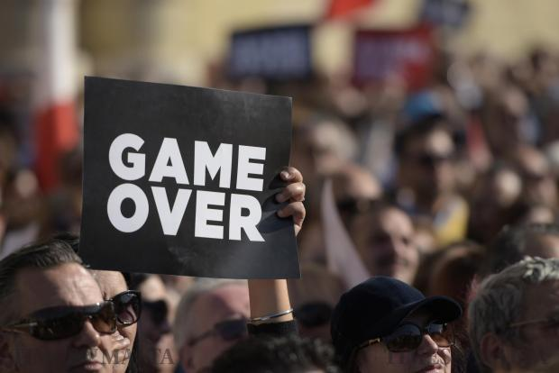 A placard with Game Over is held up during an anti-corruption protest in Valletta on April 23. Photo: Mark Zammit Cordina