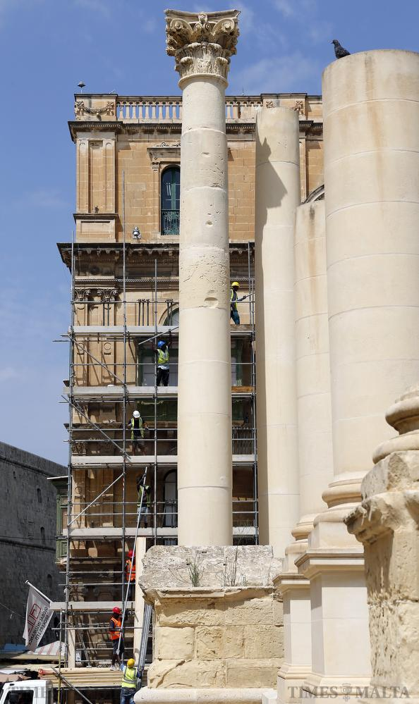 Workers erect scaffolding on the facade of Palazzo Ferreria, opposite the former Royal Opera House, in Valletta on September 14. Photo: Darrin Zammit Lupi