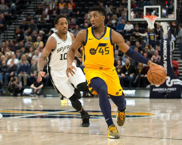 Utah Jazz guard Donovan Mitchell (45) dribbles the ball ahead of San Antonio Spurs guard DeMar DeRozan (10) during the first quarter at Vivint Smart Home Arena. Mandatory Credit: Russ Isabella-USA TODAY Sports