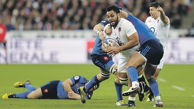 England's Billy Vunipola charges forward against France last night.