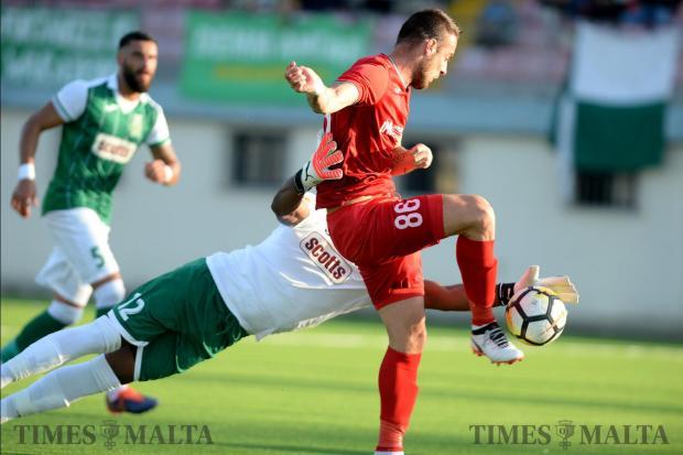 Balzan's Bojan Kaljevic makes his way around Floriana goal keeper Ini Etim Akpan during their BOV Premiership match at the Centenary Stadium in Ta'Qali on October 14. Photo: Matthew Mirabelli