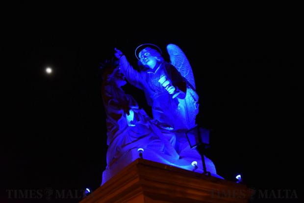 A statue is lit up blue during Maundy Thursday in Siggiewi on March 29. Photo: Mark Zammit Cordina