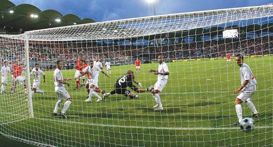 Austria's Rene Aufhauser (left) scores a goal against Malta during Friday's international friendly in Graz.