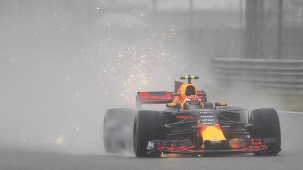 Max Verstappen drives his Red Bull car around a misty Shanghai circuit, yesterday.
