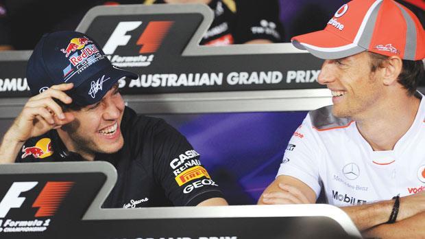 Red Bull's Sebastian Vettel shares a joke with McLaren driver Jenson Button yesterday.