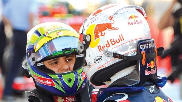 Ferrari will keep Felipe Massa (left) for 2013 despite links with Sebastian Vettel.