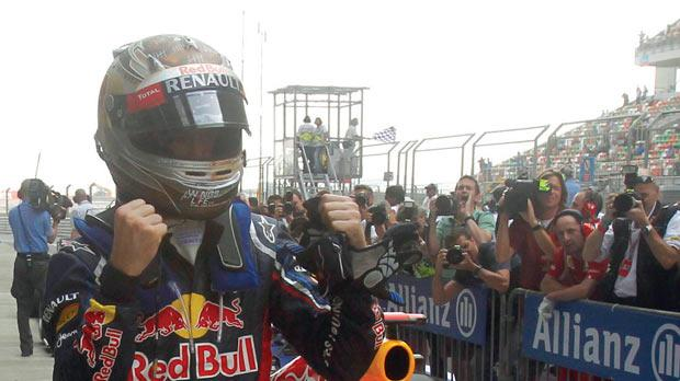 Red Bull's Sebastian Vettel celebrates his pole position yesterday.