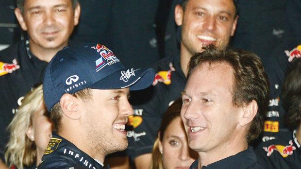 Sebastian Vettel with Red Bull chief Chris Horner.