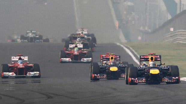 Red Bull duo Sebastian Vettel (right) and Mark Webber lead Ferrari's Fernando Alonso at the Indian Grand Prix.
