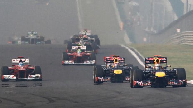 Red Bull duo Sebastian Vettel (right) and Mark Webber lead Ferrari's Fernando Alonso at the Indian Grand Prix.